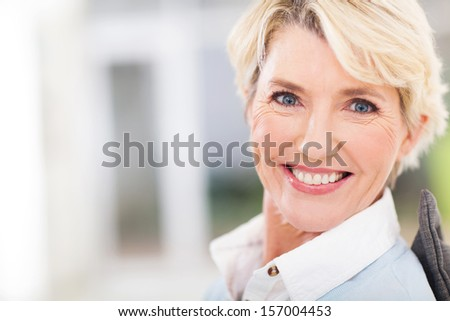 beautiful senior woman closeup portrait at home - stock photo