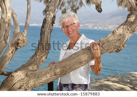 beautiful senior woman outdoors - stock photo