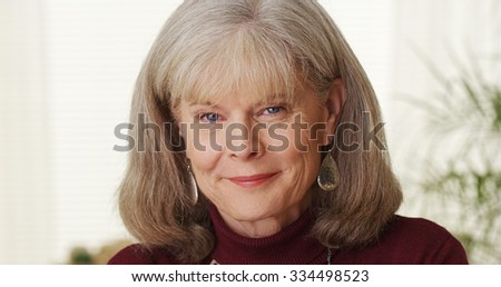 Beautiful senior woman smiling - stock photo