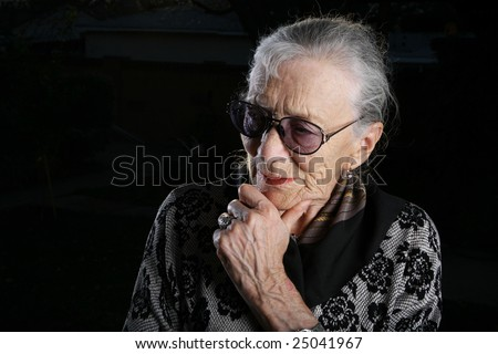 Beautiful senior woman thinking - stock photo