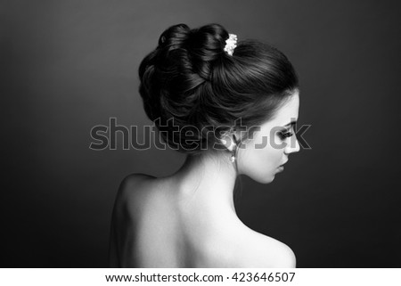Beautiful sensual brunette with elegant hairstyle. Wedding accessories. Fashion photo - stock photo