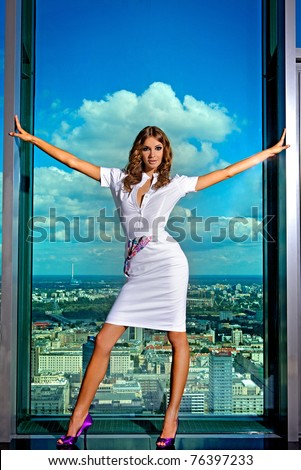 beautiful sensual brunette young woman on the background of the city - stock photo
