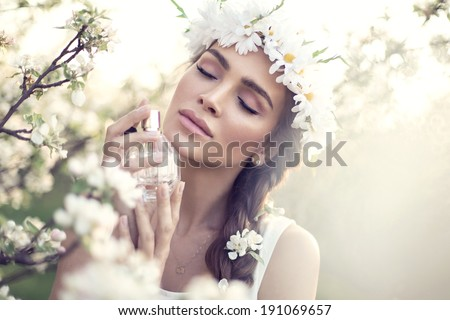 Beautiful sensual woman applying perfume - stock photo