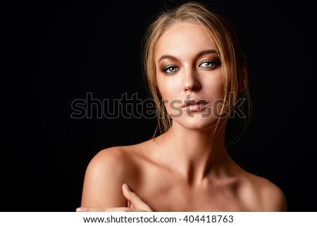 Beautiful sensual woman posing over black background. Passion, desire. - stock photo