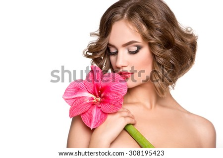 Beautiful sensuality woman with fresh skin of face and flower - white background - stock photo