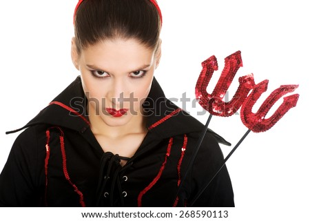 Beautiful serious angry woman in devil carnival costume. - stock photo
