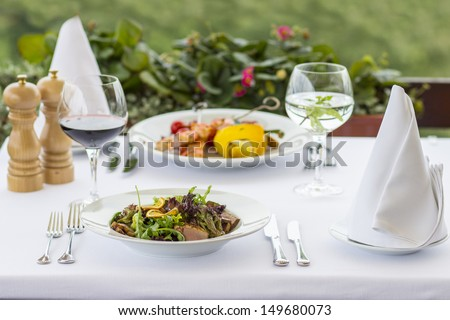 Beautiful served food on plates - stock photo