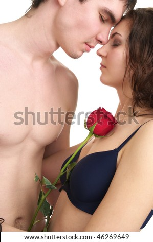 Beautiful sexual half naked couple with red rose isolated over white background - stock photo