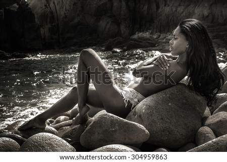 Beautiful sexy african american woman relaxing on the beach. Summer style. Perfect slim body. - stock photo