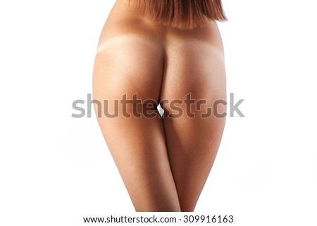 beautiful sexy ass with traces of tan. studio shot. isolated. white background. - stock photo
