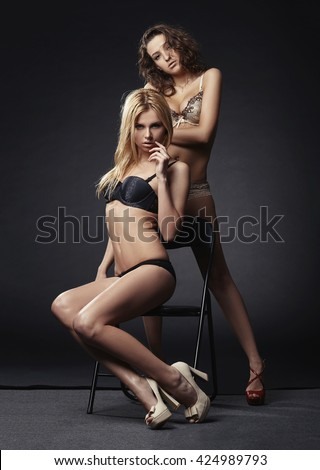 beautiful sexy blond and brunette girls - stock photo