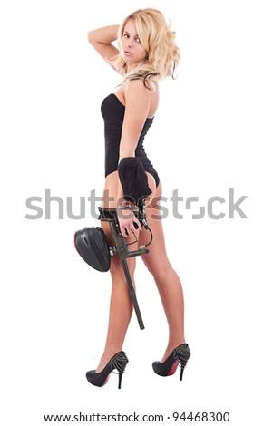 Beautiful sexy blond girl isolated holding paintball gun - stock photo