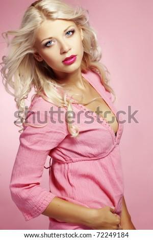 Beautiful sexy blond woman studio shot - stock photo