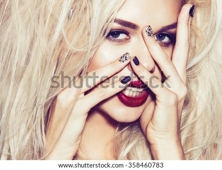 Beautiful sexy blonde girl with sensual lips, fashion hair, black nails. Beauty face. Instagram filters. Picture taken in the studio  - stock photo