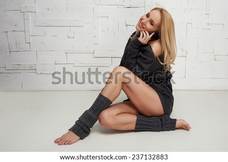 Beautiful sexy blonde with perfect athletic slim figure engaged in yoga, pilates, exercise or fitness, lead healthy lifestyle, and eats right relaxes meditation - stock photo