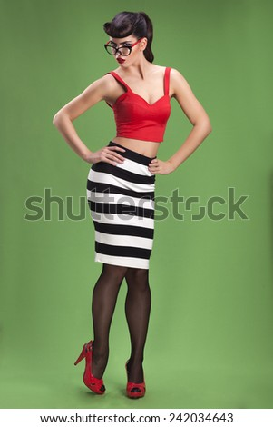 Beautiful sexy brunette pin up girl in striped dress  - stock photo