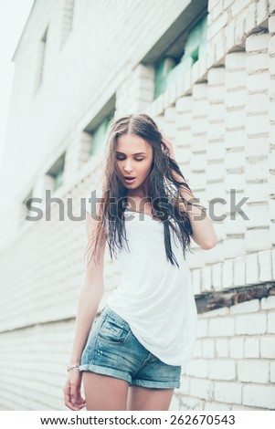 beautiful sexy brunette with wet hair on a hot day - stock photo