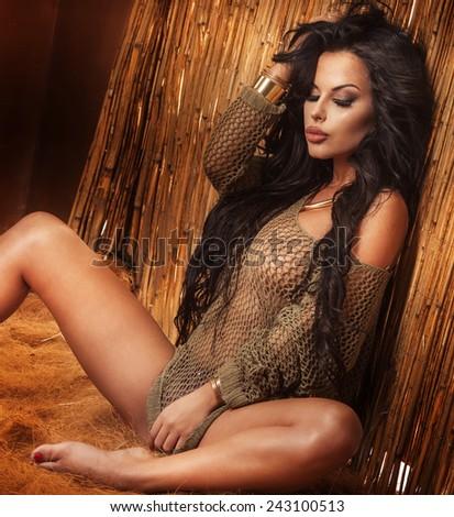 Beautiful sexy brunette woman relaxing. Girl with perfect body. Studio shot. - stock photo