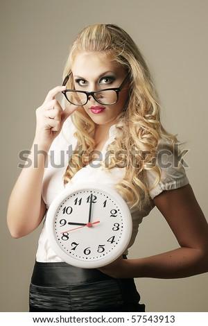 Beautiful sexy business woman with watch - stock photo