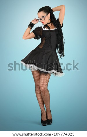 Beautiful sexy french maid with glasses - stock photo