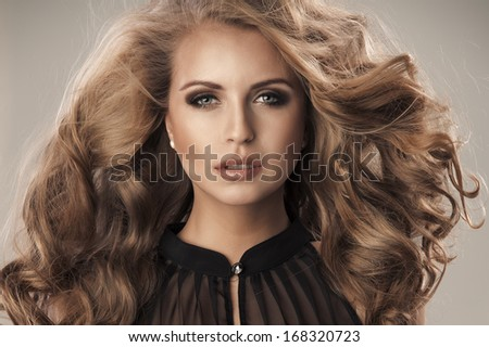 Beautiful sexy fresh young woman in party dress smiling happy looking at camera with big smile. - stock photo