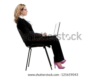 Beautiful sexy girl in a business suit posing in the studio on a white background, isolated - stock photo