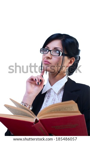 beautiful sexy girl in the office business clothes in a black jacket and white blouse with glasses sits and thinks the book - stock photo