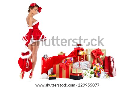 beautiful sexy girl wearing santa claus clothes with christmas gifts - stock photo