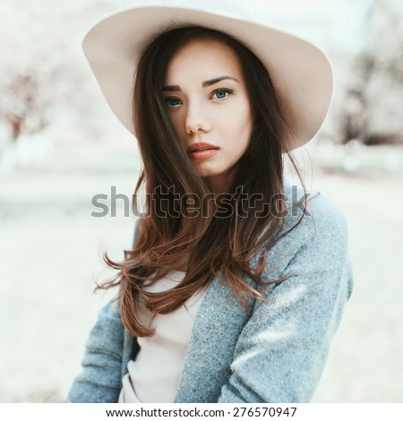 Beautiful sexy girl with a hat posing at the camera - stock photo