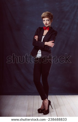 beautiful sexy girl woman in a suit with a bow tie shoes success thoughtful look smile - stock photo