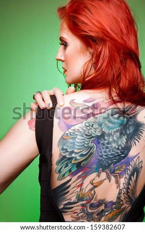 Beautiful sexy glamorous girl with tattoos. tattoos. - stock photo
