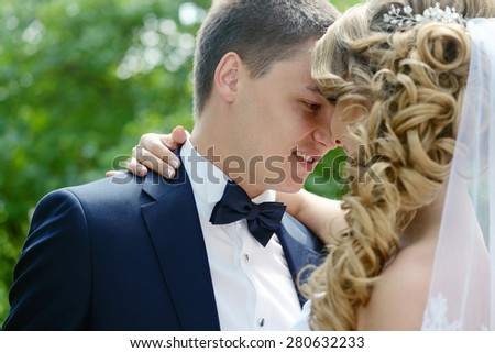 Beautiful sexy model girl. Wedding couple. Man in suit. Beauty blonde bride with brunette groom. Close up female and male portrait. Woman with curly hair and lace veil. Cute lady and guy outdoors - stock photo