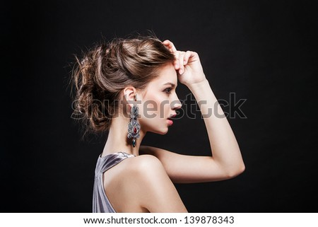 beautiful sexy model on black background. evening make up and hairstyle - stock photo