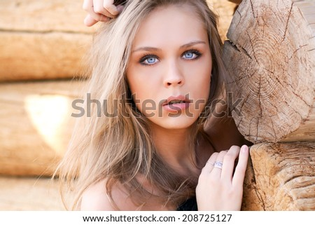 Beautiful sexy model on the background of wooden wall - stock photo