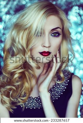 Beautiful Sexy Woman face closeup, makeup with Red Lips, green eyes and red Nails. Beauty blond Girl. Makeup, Hairdo and Manicure.Sensual Mouth. Metal  background. Snow queen concept. - stock photo