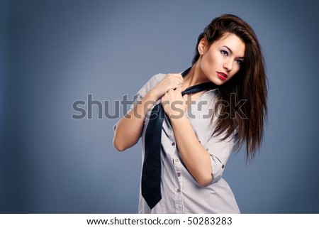 Beautiful sexy woman in a man's shirt and tie - stock photo