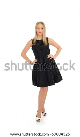 Beautiful sexy woman in elegant dress standing. studio shot. isolated on white background - stock photo