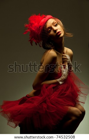 Beautiful sexy woman in red hat with net veil. Retro portrait - stock photo