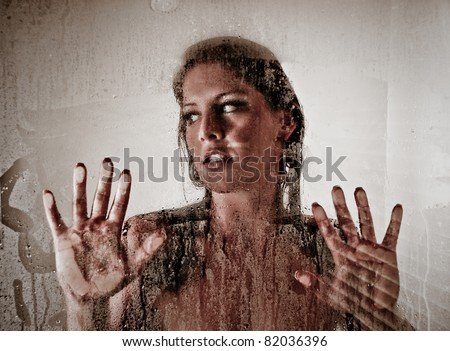 Beautiful Sexy Woman Looking through Steamed Shower Glass - stock photo