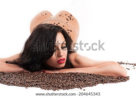 beautiful sexy woman lying with coffee beans - stock photo