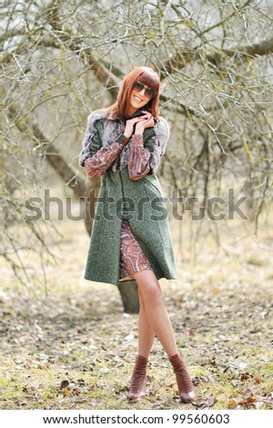 Beautiful sexy woman on the nature in sunglasses. Full-length portrait - stock photo