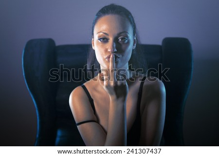 Beautiful sexy woman showing middle finger obscene gesture - stock photo