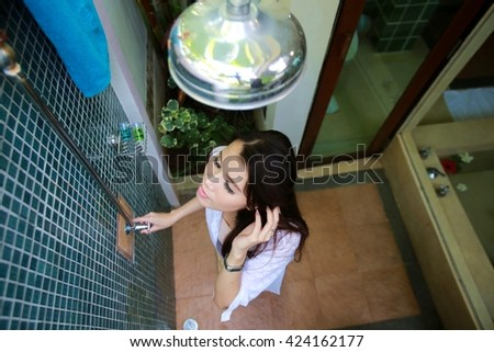 Beautiful sexy woman taking a shower./ Woman taking a shower  - stock photo