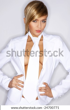 Beautiful sexy woman wearing white suit and tie - stock photo