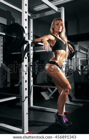 beautiful sexy woman with perfect abdominal muscles at the gym - stock photo