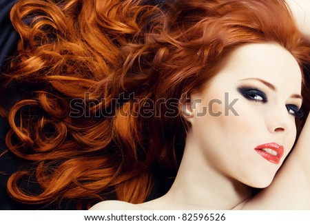 Beautiful sexy woman with red hair - stock photo