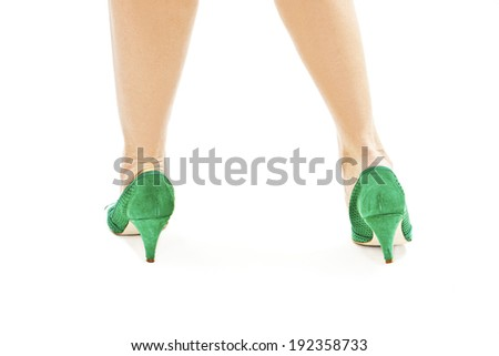 Beautiful, sexy, women's legs in green shoes from the back. Isolated on white background  - stock photo