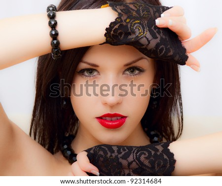 beautiful sexy young brunette woman with luxury accessories, sensual looking at camera - stock photo