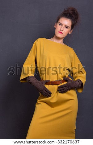 Beautiful sexy young business woman brown hair with natural skin wearing yellow dress business clothes for meetings walks autumn fall collection perfect body shape party style. - stock photo
