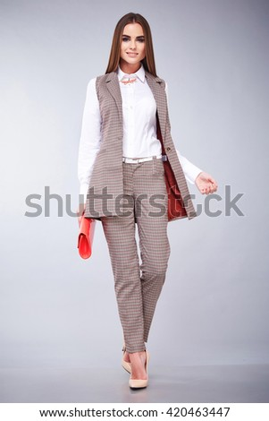 Beautiful sexy young business woman brunette hair with evening make-up wearing casual suit office style high-heeled shoes  business clothes for meetings and walks autumn collection perfect body shape - stock photo